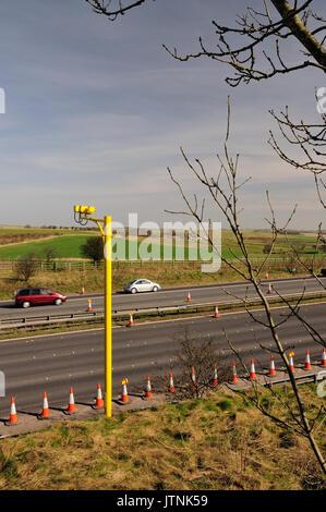 Average speed cameras at roadworks on the M4 motorway. - Stock Photo