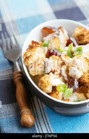 Roasted Cauliflower with Dates and Tahini Dressing - Stock Photo
