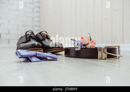 Groom's boutonniere of phlox and roses - Stock Photo