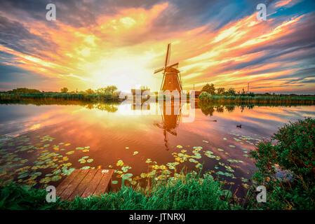 Sunrise on the Kinderdijk windmill built in 17 century, the UNESCO world heritage monuments in Alblasserdam, South - Stock Photo