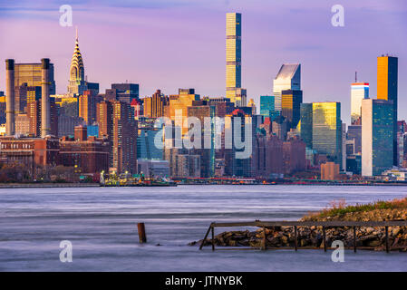 New York City Skyline on the East River. - Stock Photo