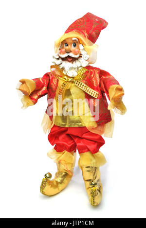 Christmas Santa Claus doll decoration isolated on a white background. A cheeky look on his face and arms outstreched - Stock Photo