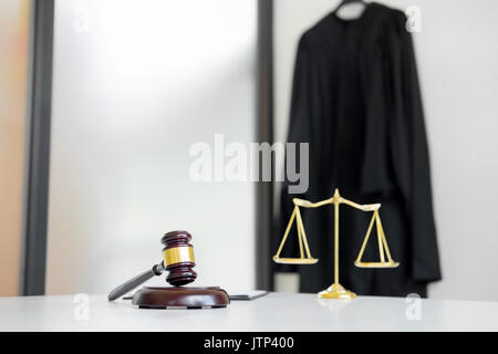 Scales of justice and gavel Judge hammer on brown wooden desk with copy space. Legislation Concept - Stock Photo