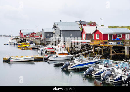Fishing village with boats and wooden buildings on stilts. Nes, Vega Island, Norway, Scandinavia - Stock Photo