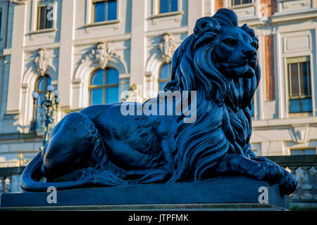 Statue of a lion in front of the Pszczyna Castle - classical-style palace. Pszczyna, Poland. - Stock Photo