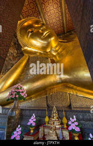 Torso of the famous Reclining Buddha statue at the Wat Pho (Po) temple complex in Bangkok, Thailand. - Stock Photo