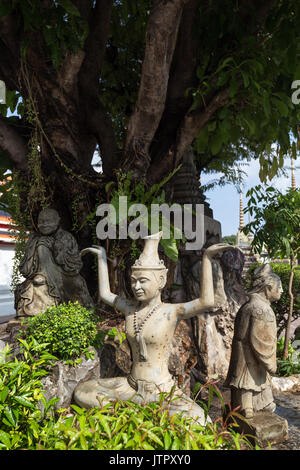 Three statues at the Wat Pho (Po) temple complex in Bangkok, Thailand. - Stock Photo