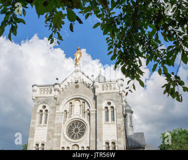Upper facade and statue on a church in a small parish, Montreal Canada - Stock Photo