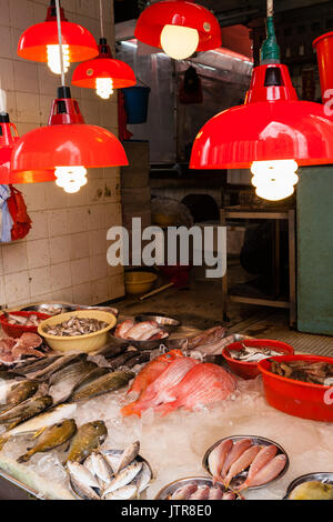 HONG KONG, JULY 5, 2017: A store selling seafood at a street market in Hong Kong's old residential district of Quarry - Stock Photo