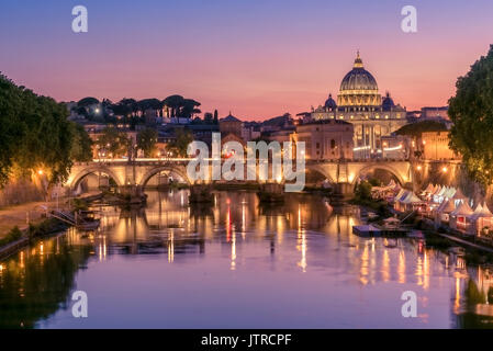View of a stunning sunset setting behind the Vatican City from Ponte Umberto I, Rome, Italy - Stock Photo