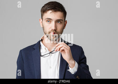 Business Concept - Portrait of a handsome businessman in suit with glasses serious thinking with stressful facial - Stock Photo