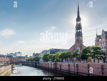 old warehouse district Speicherstadt in Hamburg, Germany under clear summer sky as seen from Zollkanal channel with - Stock Photo