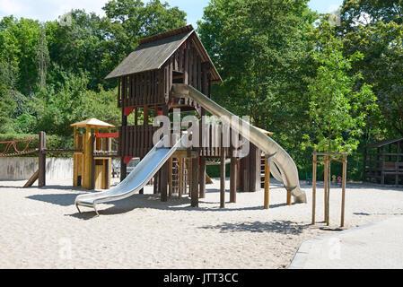 Children's playground in the park - Stock Photo