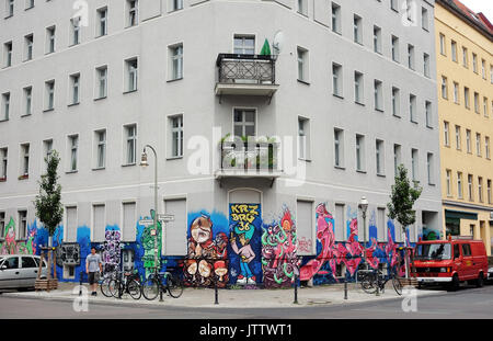 Graffiti on a building's exterior wall pictured in the corner of Eisenbahnstrasse and Wrangelstrasse in the Kreuzberg - Stock Photo