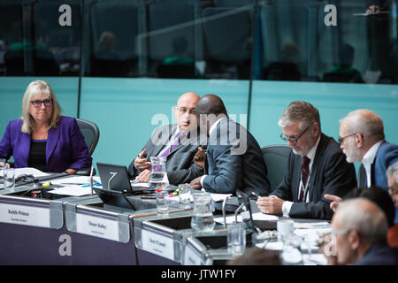 London, UK. 10th August, 2017. London Assembly Members Keith Prince and Shaun Bailey converse during Mayor's Question - Stock Photo