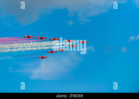 **Lyme Regis, Dorset, UK. 10th Aug 2017. The RAF Red arrows dazzle crowds with their low precision flying air show over Lyme Regis at the annual Regatta & Carnival Week in West Dorset on a warm sunny evening. Credit: Dan Tucker/Alamy Live News