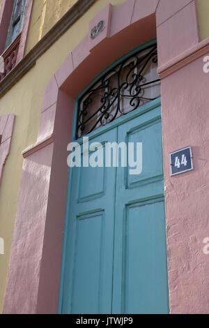 Street number 44 on a light blue door in Santa Cruz de Tenerife, Canary Islands, Spain - Stock Photo
