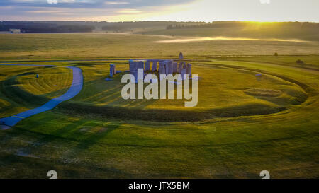 Sunrise at Stonehenge with the start of a new day - Stock Photo