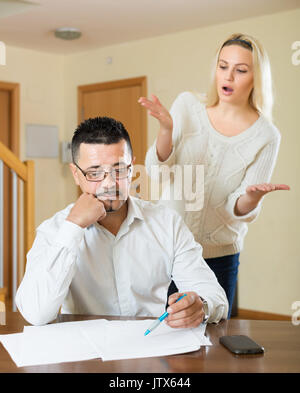 Quarrel in the couple due to lack of money - Stock Photo