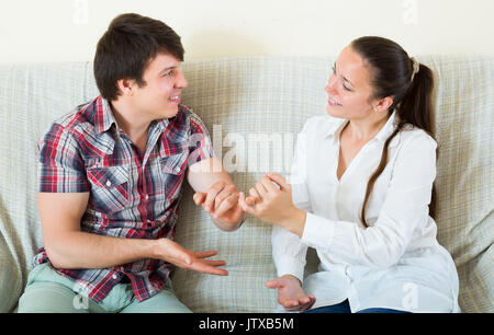 Smiling beautiful couple reconciled after a quarrel. Focus on woman - Stock Photo