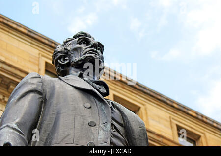 Bronze statue of Abraham Lincoln stoically looks out over downtown Cleveland, Ohio, USA. - Stock Photo
