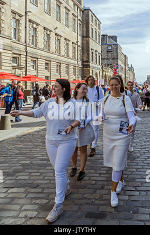 Swiss group L'auftritt promoting show Leere Zeit - Idle Time in Edinburgh Festival Fringe 2017 in the High Street - Stock Photo