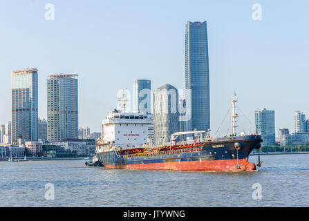 A cargo vessel registered in Mumbai, India travels up the Huangpu River in Shanghai, China. - Stock Photo