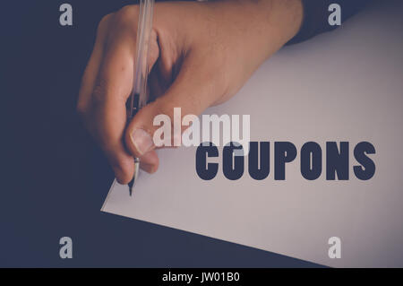 coupons written on white paper - Stock Photo