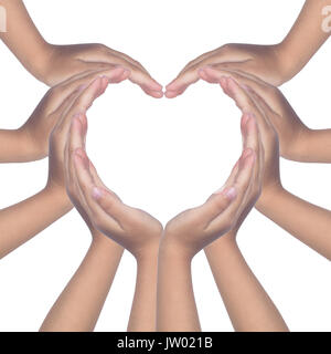 Child's hands making a heart shaped in isolated white background - Stock Photo