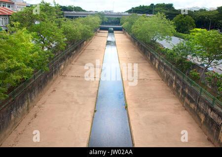 Rainwater stream running through the city - Stock Photo