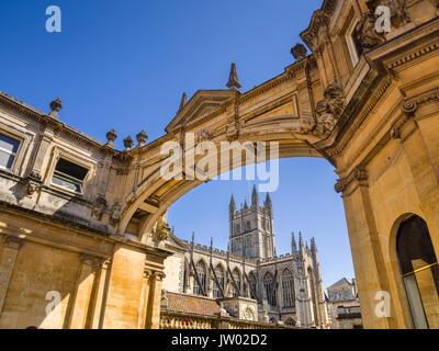 Bath, Somerset, England, UK - Bath Abbey seen through the York Street Arch. - Stock Photo