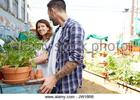 Couple shopping for plants at plant nursery - Stock Photo