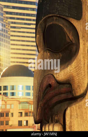 Totem pole with downtown, Victor Steinbrueck Park, Seattle, Washington - Stock Photo