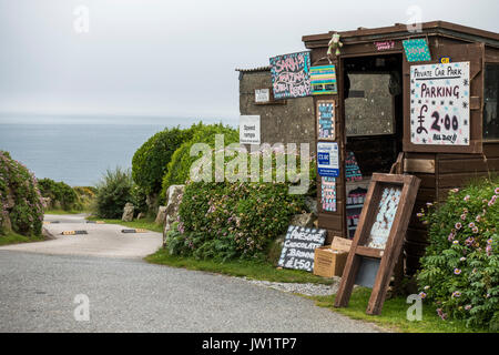 Shed adorned with various items, serving as a collection point for a private car park near to Gwynver Beach, near - Stock Photo