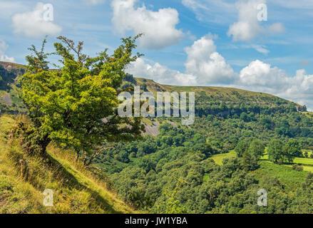The Llangattock limestone escarpment over Crickhowell in the Brecon Beacons National Park - Stock Photo