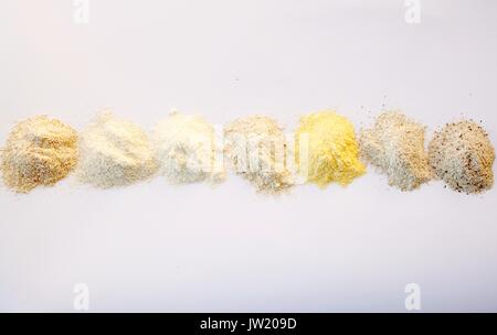 Seven different types of flour on white background - Stock Photo