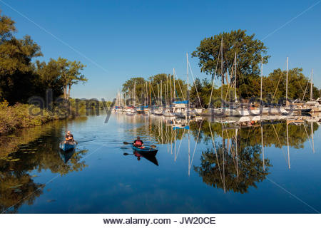 canoe canoeing Toronto Islands Park lagoon trees reflected Toronto Ontario Canada - Stock Photo