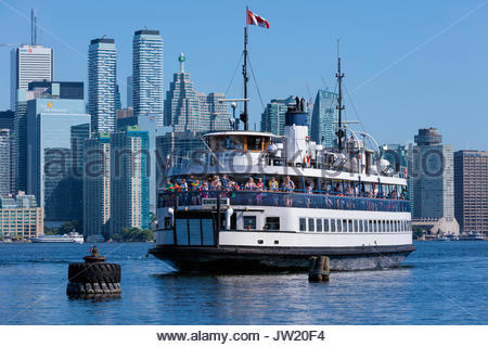 ferry boat arriving Toronto Islands Park Toronto skyline cityscape waterfront Toronto Ontario Canada - Stock Photo