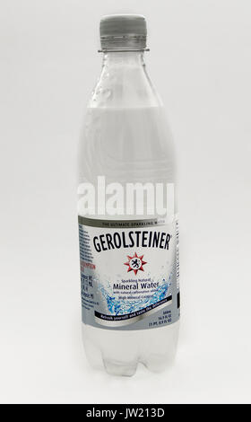 Bottle of Gerolsteiner mineral water stands against white background. - Stock Photo
