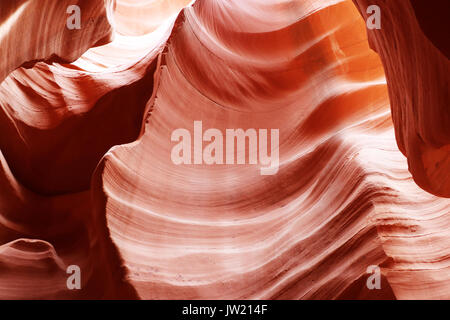Swirls of old red  sandstone wall abstract pattern in Lower Antelope Canyon, Page, Arizona, USA. - Stock Photo