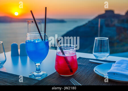 Colourful cocktails, Imerovigli in the evening, a village near Fira on the Greek island of Santorini called 'the - Stock Photo