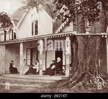 Harriet Beecher Stowe (1811-1896) and her husband Cyril Stowe, along with their daughters, on the porch of their - Stock Photo