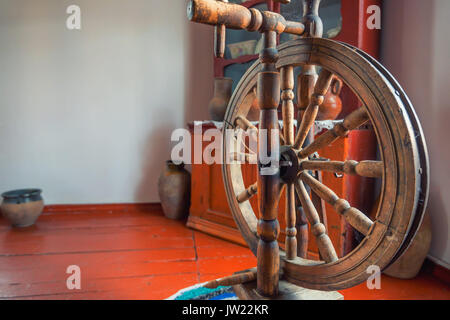 Old wooden spinning wheel - Stock Photo