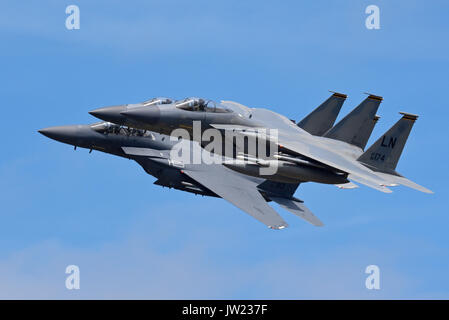 Three US Air Force F-15 fighter jet planes from RAF Lakenheath, two F-15C fighters and one F-15E Strike Eagle multi - Stock Photo