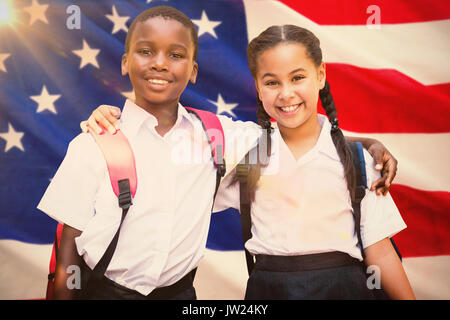 Portrait of students against white background against close-up of us flag - Stock Photo