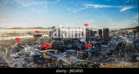 Red wifi symbol against city - Stock Photo