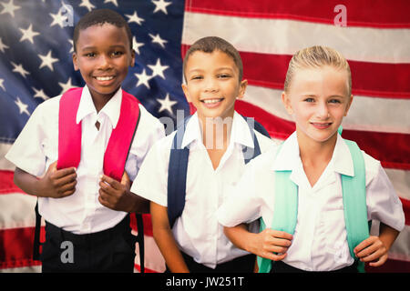 Portrait of students in uniforms against close-up of an flag - Stock Photo