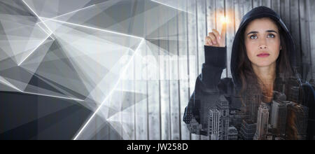 Hacker using digital screen against abstract glowing black background - Stock Photo
