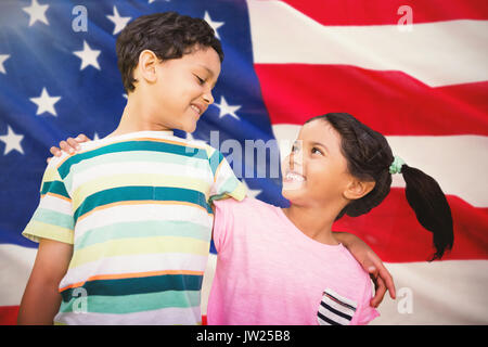 Happy friends against white background against close-up of us flag - Stock Photo