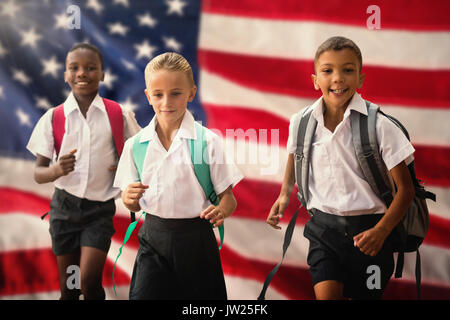 Students running against white background against close-up of an flag - Stock Photo